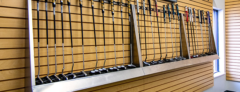 Putter lined up on a wall.